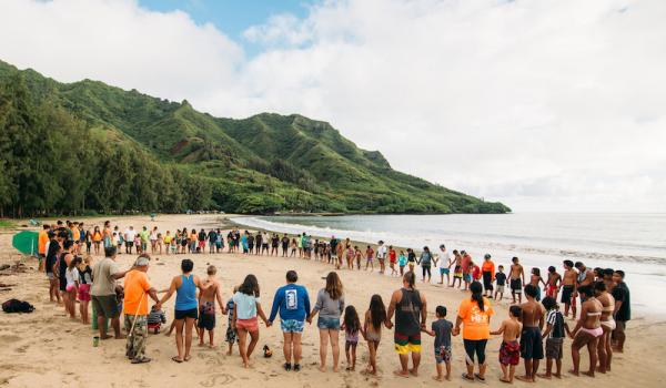 Community prayer Hukilau, Kahana Circle, at Koolauloa, Oahu, Hawaii, USA.